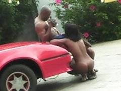 Horny black Brazillian chick bent over car gets ass fucked